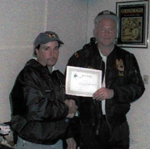 Larry LeoGrande owner of K9 Obedience Training receiving his Certification for Professional Dog Trainer from Owen C Tober. Owner Director of Training Amsel Training Kennels.